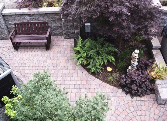 Landscaping and pavers create a tranquil space.