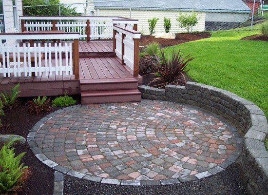 All-weather decks and paver patios transform this property.