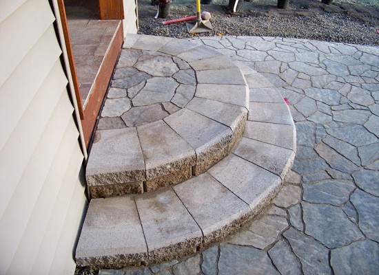 Stone steps enhance entryways.