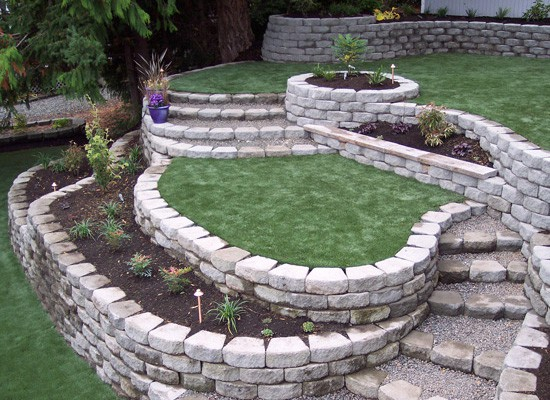 Stone retaining walls create a beautiful, terraced yard.